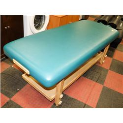 GREEN LEATHERETTE MASSAGE TABLE