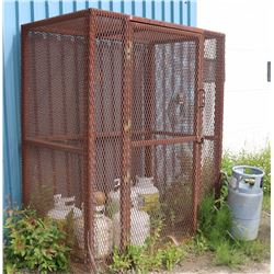 METAL CAGE WITH PROPANE TANKS