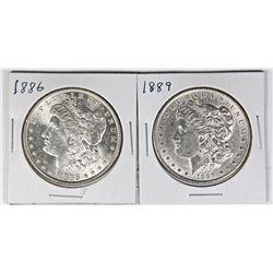 1886 AND 1889 MORGAN SILVER DOLLARS