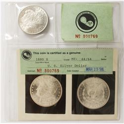 TWO IGA GRADED SILVER DOLLARS: