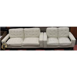 "86"" IVORY LEATHER SOFA WITH MATCHING 60"" LOVESEAT."