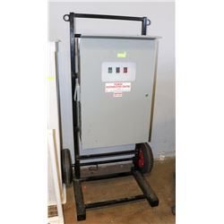 ELECTRIC DISTRIBUTION PANEL ON RACK WITH WHEELS.