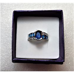 16)  SILVER TONE SETTING WITH BLUE LAB