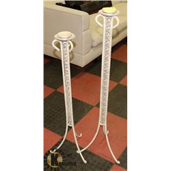 PAIR OF METAL FLOOR CANDLE HOLDERS.