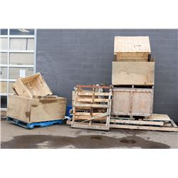STACK OF WOOD CRATES AND LARGE PALLETS