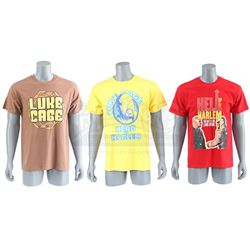 Lot # 654: Three Luke Cage Novelty Shirts
