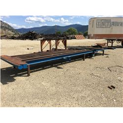 APPROX. 24' HEAVY DUTY STEEL WORK BENCH WITH ROLLERS AND TRACKS