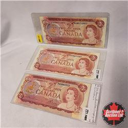 Canada $2 Bills 1974 - Group of 3: Lawson/Bouey RW4886972; Crow/Bouey AGN9712977; Crow/Bouey ARD8872