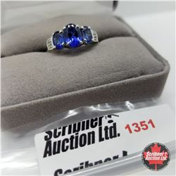 CHOICE OF 29 RINGS:  1351 Ring - Size 9: Simulated Blue Sapphire White Topaz (Platinum Overlay)