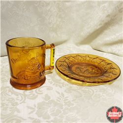 Cup & Saucer: Tom Tom the Pipers Son & Humpty Dumpty (Amber Glass)