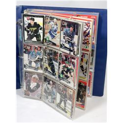 BOOK OF ASSORTED HOCKEY CARDS.