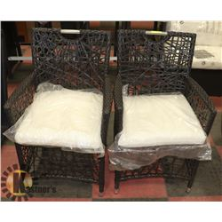 9) RATTAN STYLE PAIR OF ARM CHAIRS.