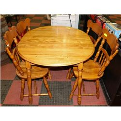 "SOLID MAPLE TABLE (49""X40""X29.5"") WITH 4 CHAIRS."