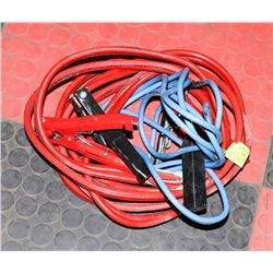 SET OF BOOSTER CABLES AND EXTENSION CORD.