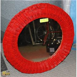 "24"" ROUND RED WICKER MIRROR."
