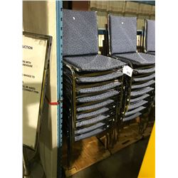 STACK OF BLUE METAL FRAMED STACKING CHAIRS ON CART