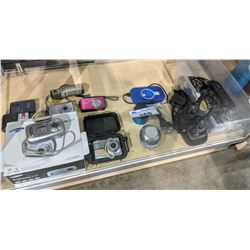 LARGE LOT OF ELECTRONICS INCLUDING DIGITAL CAMERAS, SPEAKERS, BATTERY, WALKIE TALKIES AND MORE