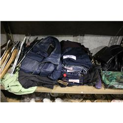 SHELF OF CLOTHING INCLUDING JEANS, JACKETS, BOOTS, PURSE AND MORE