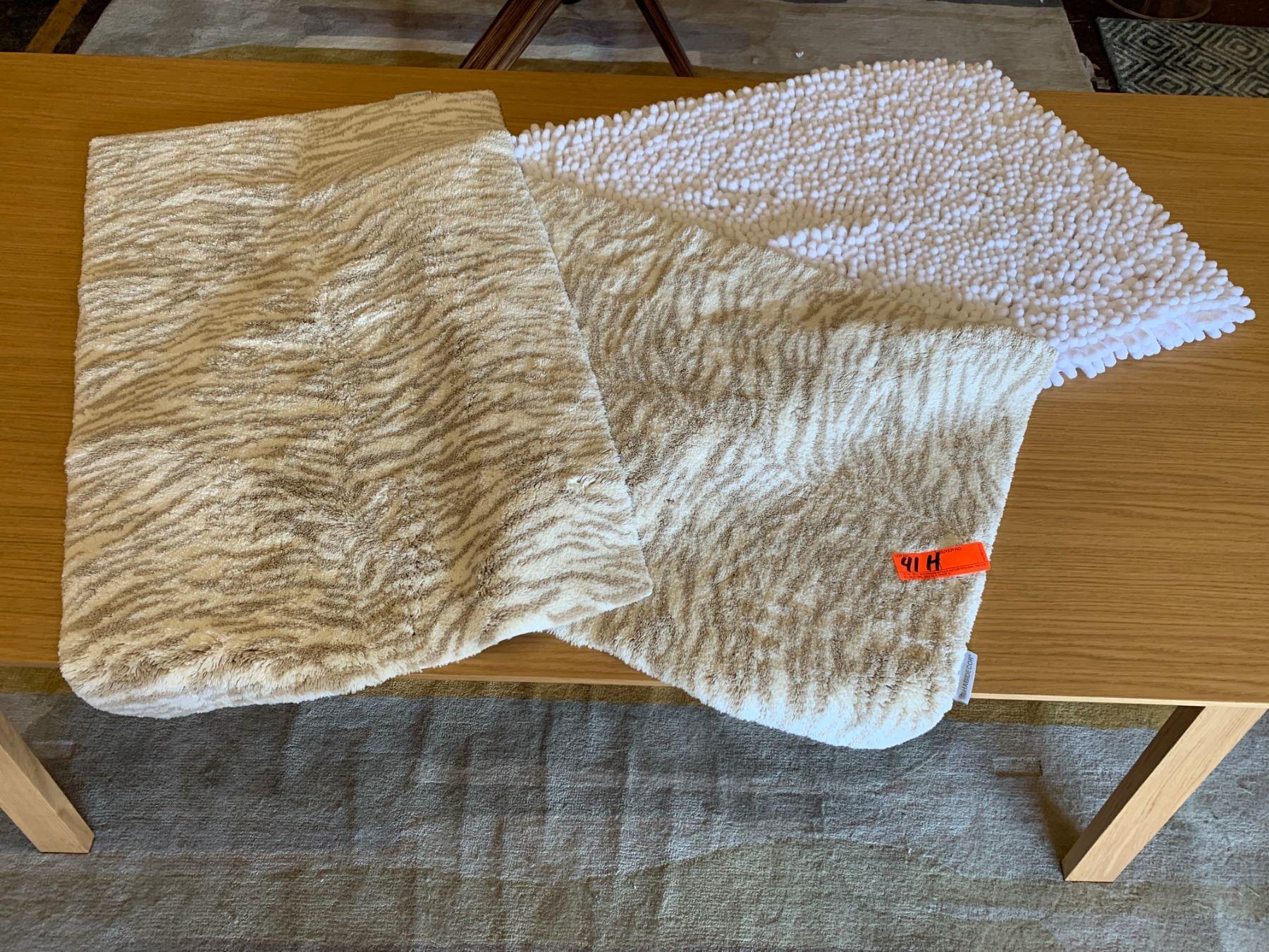 Picture of: 2 Habidecor Animal Print Bath Rugs 1 Plush White Pompom Bath Rug Oahu Auctions