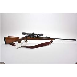 Remington Model 700 .7 MM Rem Mag Cal Bolt Action Rifle w/ 24  bbl [ blued finish starting to fade,