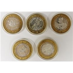 5 PCS. TREASURE ISLAND CASINO TOKENS