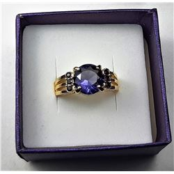 8)  ROUND AMETHYST RING SET IN YELLOW