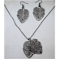 19)  SILVER TONE FILAGREE LEAF PENDANT ON