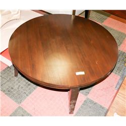 BOUTIQUE ROUND WOOD TONE COFFEE TABLE.