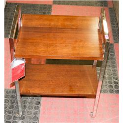 BOUTIQUE CHROME AND WOOD TONE END TABLE ON WHEELS