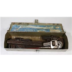 SMALL TOOL BOX WITH 3 VINTAGE PIPE WRENCHES.
