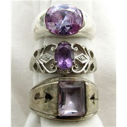 LOT OF FOUR STERLING RINGS PURPLE