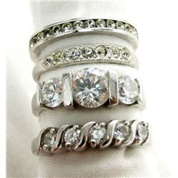 FOUR SHINY STERLING RINGS SIZES 5-8