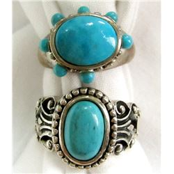 2 TURQUOISE COLORED SILVER RINGS