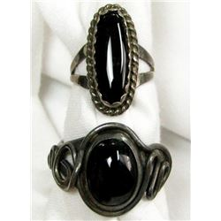 TWO SILVER RINGS WITH BLACK STONES