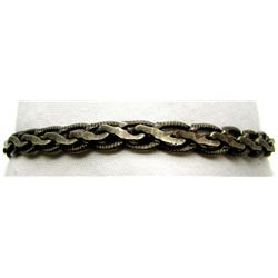 7 INCH ANTIQUE STERLING BRACELET WITH BRAIDED