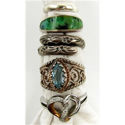 6-STERLING RINGS WITH BLUE STONES.