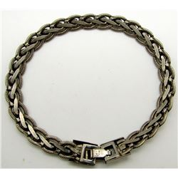 7 INCH STERLING BRACELET WITH BRAIDED DESIGN