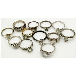 12-STERLING RINGS WITH CLEAR CENTER STONES