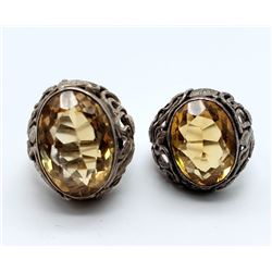 2-LARGE BLING RINGS WITH LARGE YELLOW CNTR