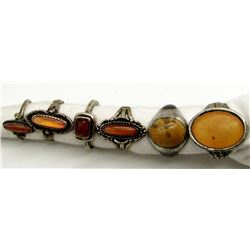 6-STERLING RINGS WITH VARIOUS ORANGE STONES