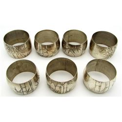 7-STERLING NAPKIN RINGS WITH ENGRAVED DETAILS