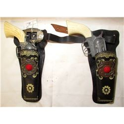 2 VINTAGE PONY BOY TOY CAP GUNS WITH HOLSTERS