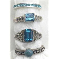 4-STERLING RINGS WITH BLUE STONE ACCENTS