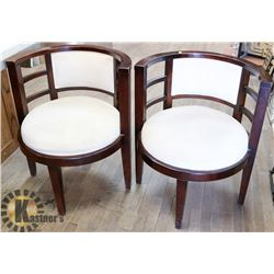 PAIR OF WOOD AND MICROFIBER HOME ACCENT CHAIRS.
