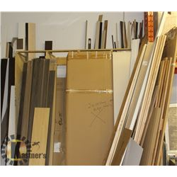 LARGE LOT OF ASSORTED CABINET TRIMS AND DOORS.