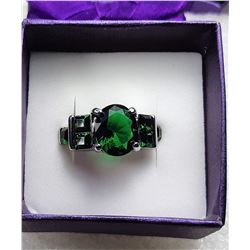 11)  OVAL CZ EMERALD RING WITH  BAGETTE