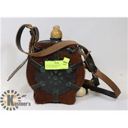 VINTAGE WOODEN REAL LEATHER CANTEEN WITH FUR.