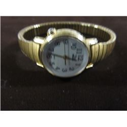 ROUND FACED GOLD TONE WITH EXPANSION BRACELET TIMEX INDIGLO WATCH