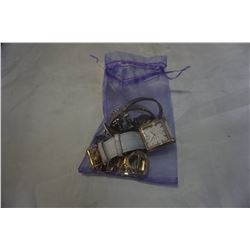 DESIGNER BRAND NAME WATCHES IN PURPLE BAG