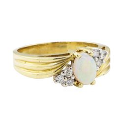 0.50 ctw Opal and Diamond Ring - 14KT Yellow Gold